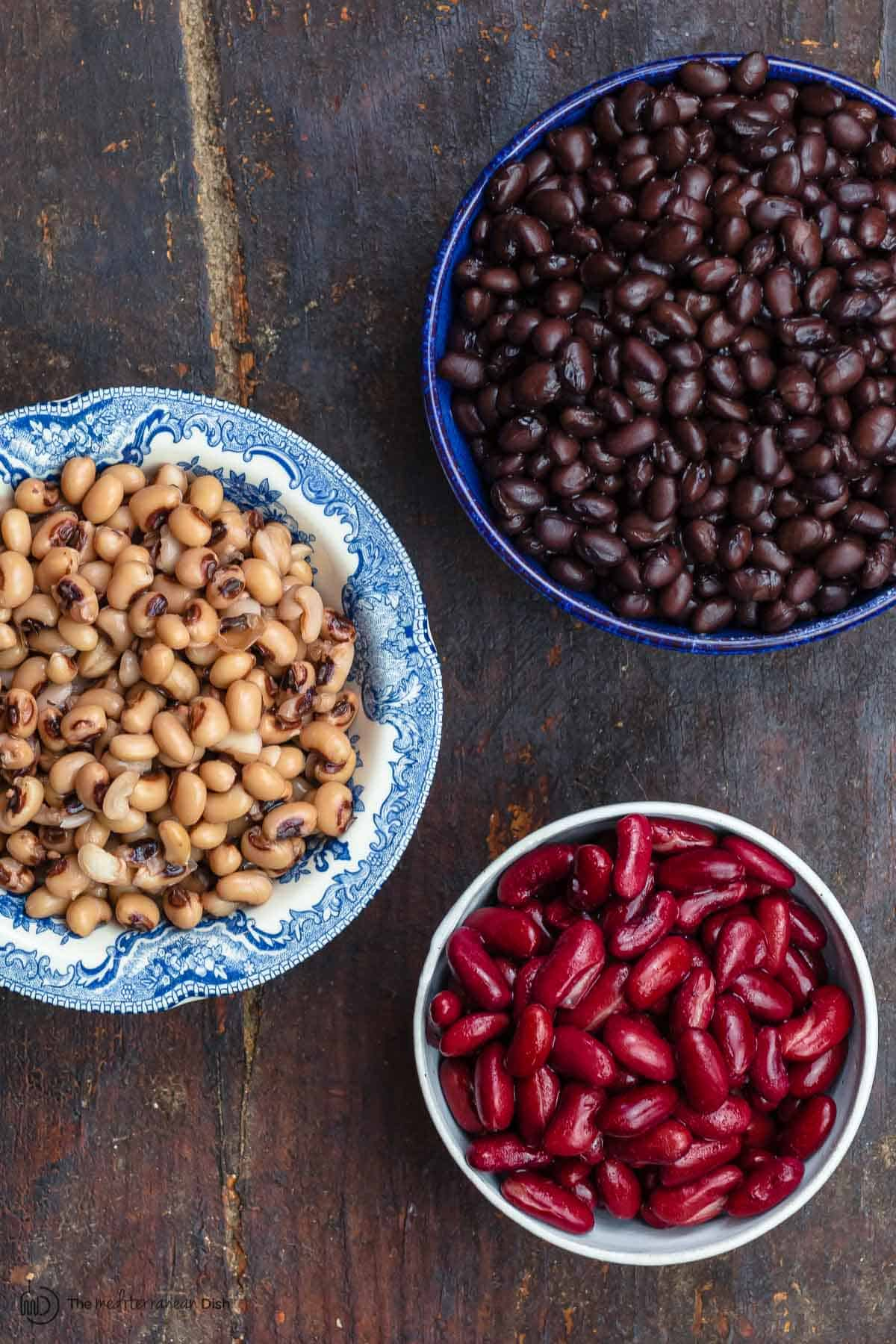 A variety of beans in different bowls