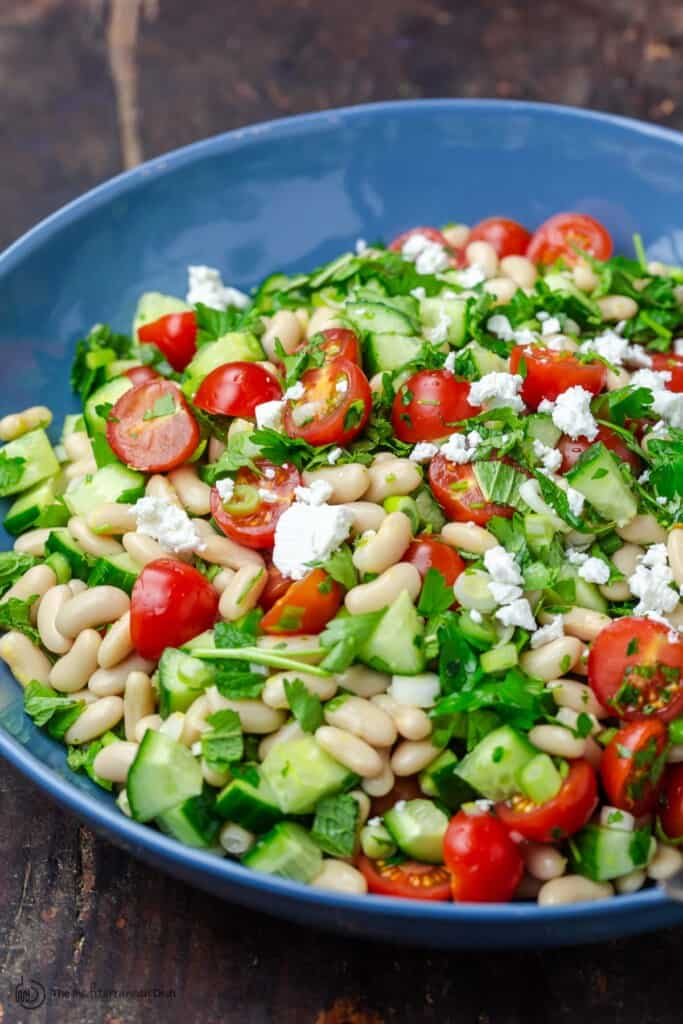 White Bean Salad with chopped vegetables and fresh herbs