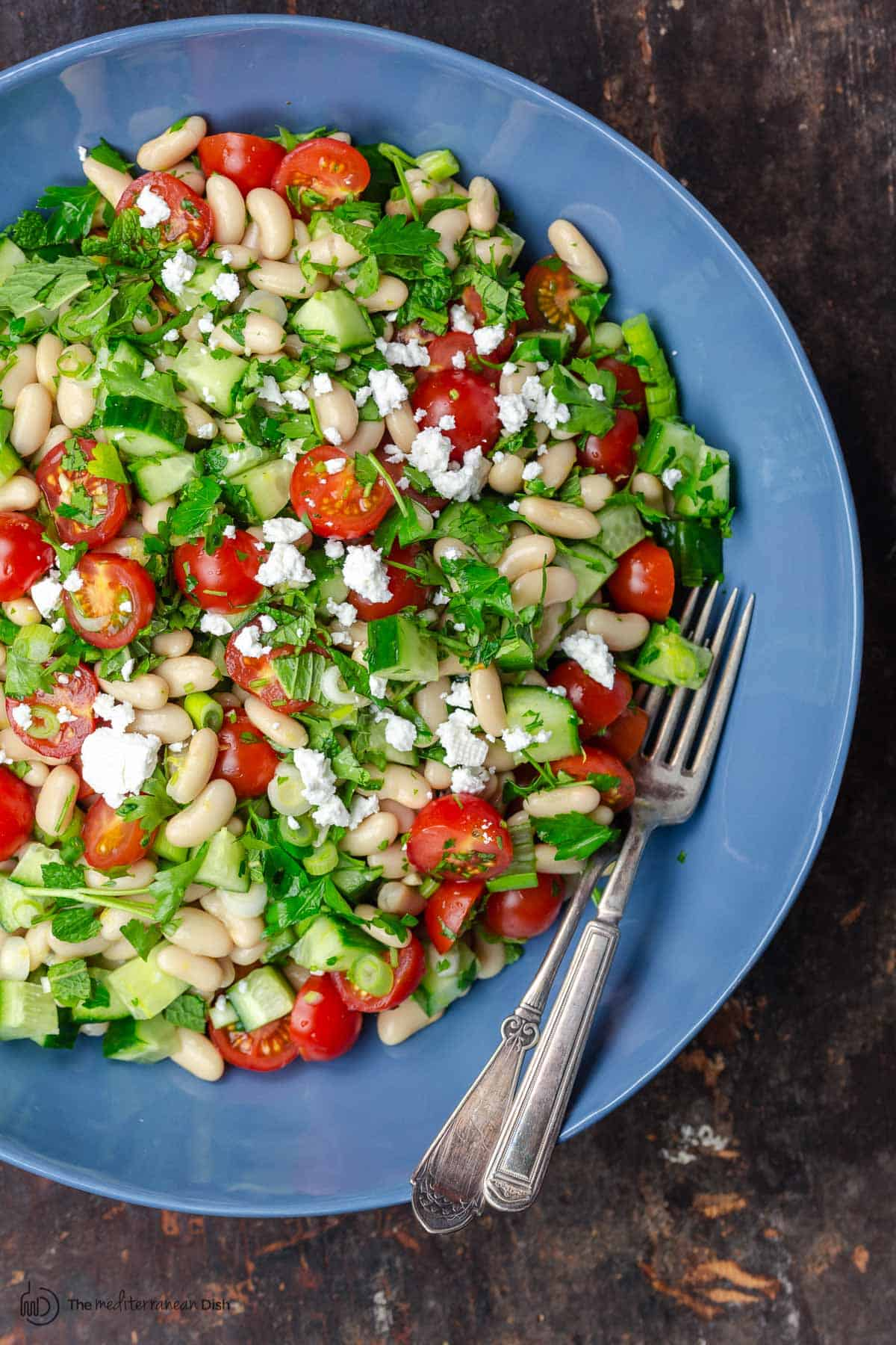 White bean salad topped with feta cheese. Ready to serve