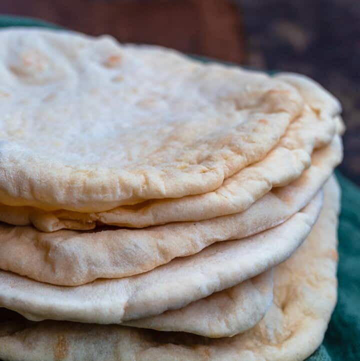Stack of pita bread over a kitchen towel
