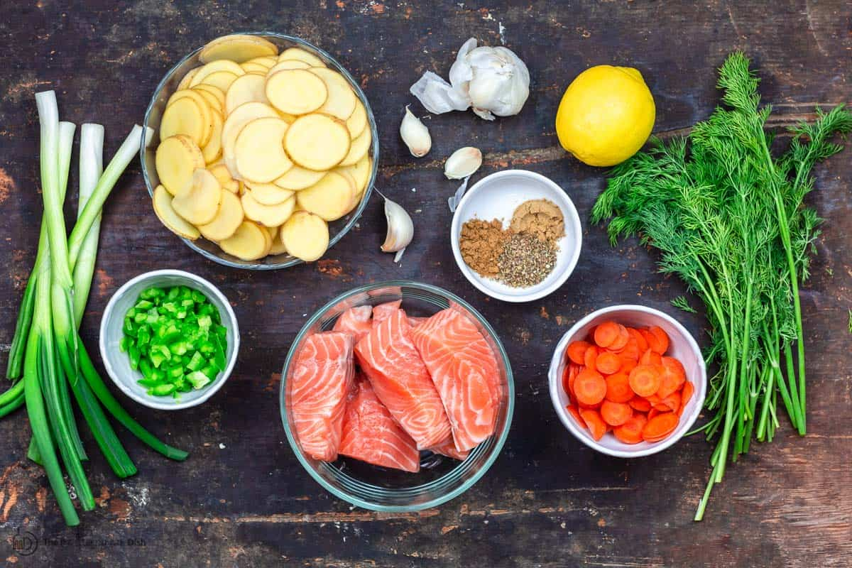Ingredients for salmon soup. Salmon, potatoes, carrots, spices, fresh dill, green onions, lemon, garlic, bell peppers
