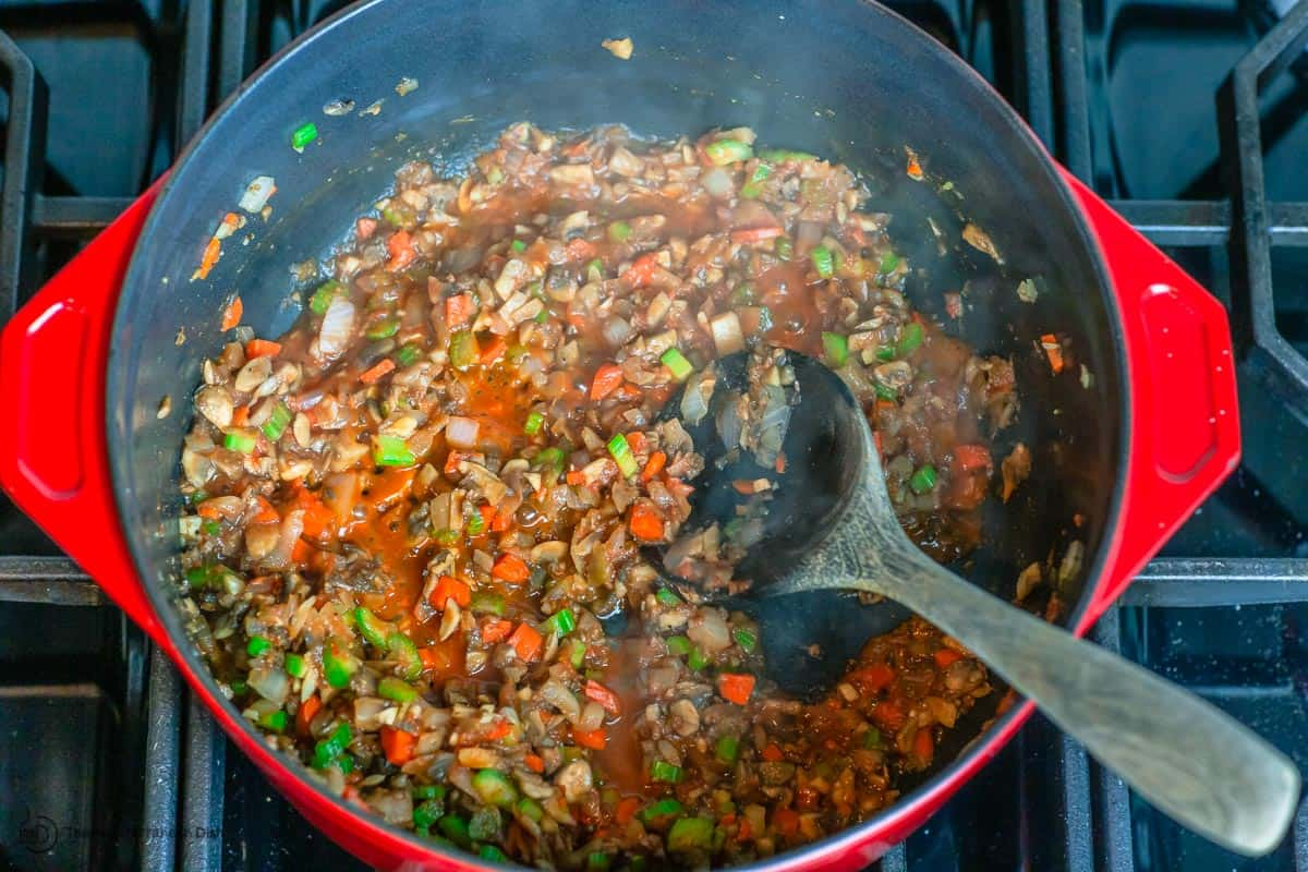 Crushed tomatoes and spices added to the pot of satueed veggies