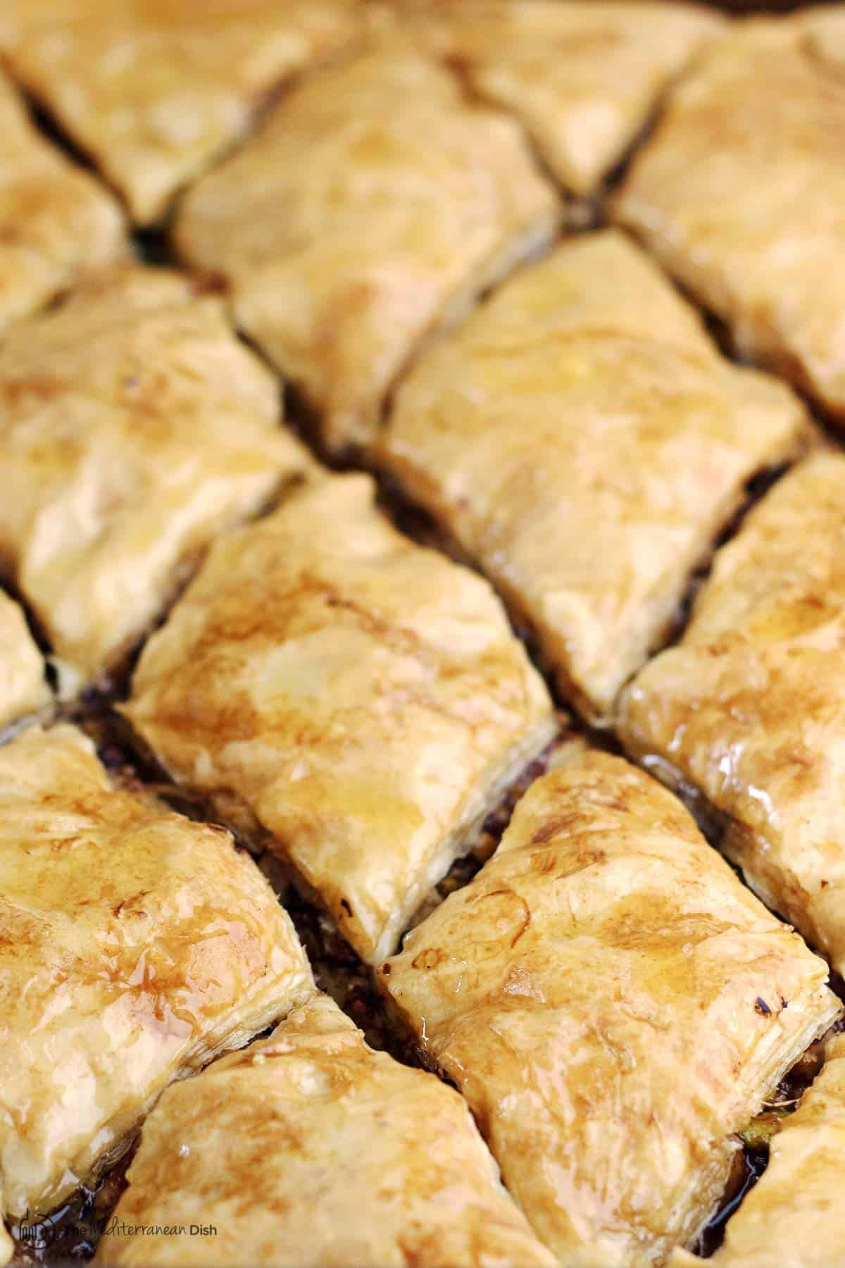 Greek honey baklava pieces in pan