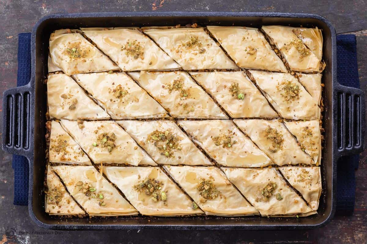 Baklava with honey syrup and crushed pistachio garnish