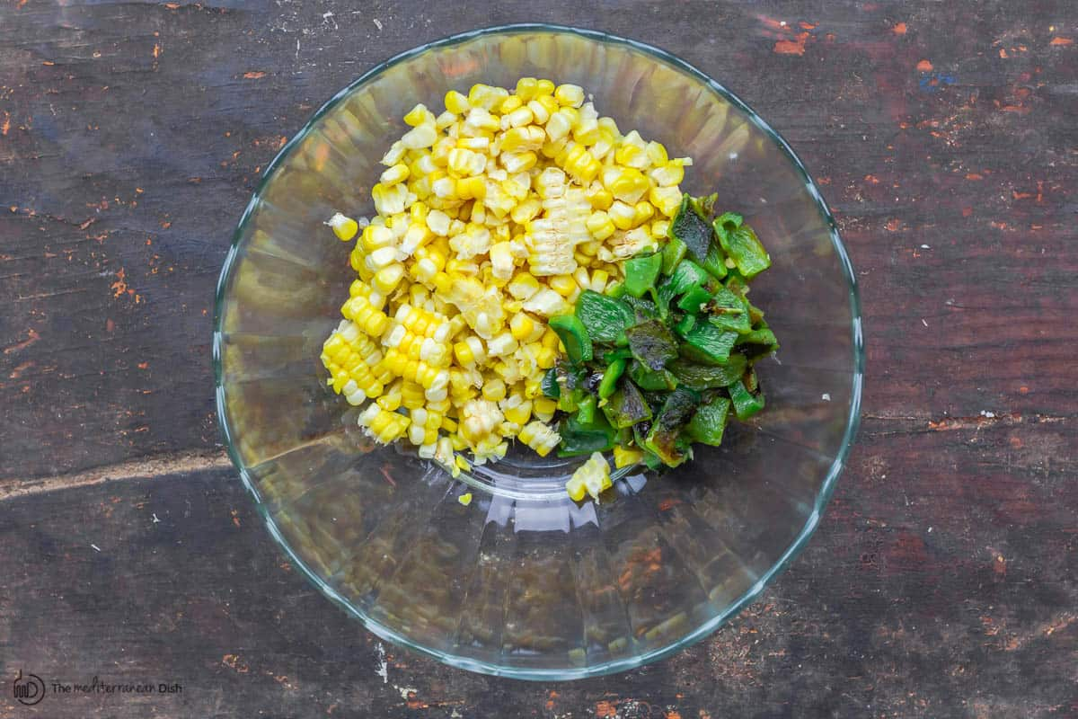 chopped pablano added to the bowl with the corn