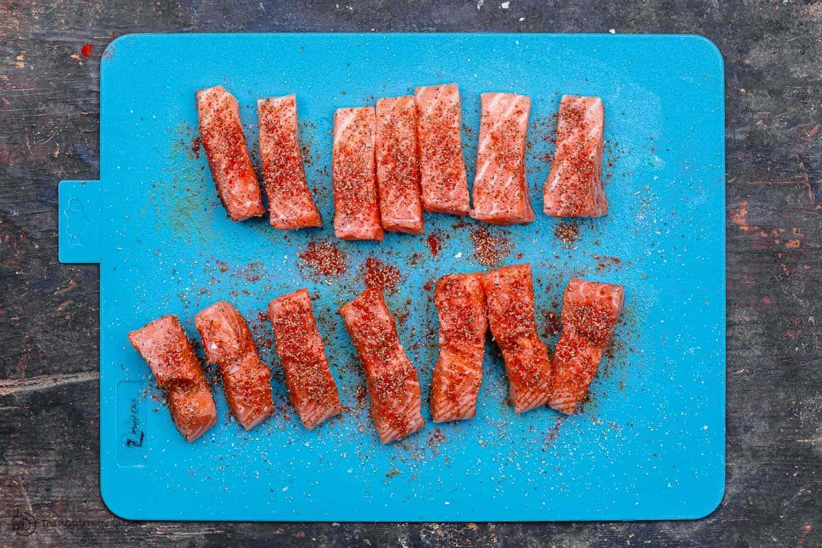 Seasoned raw salmon fish sticks