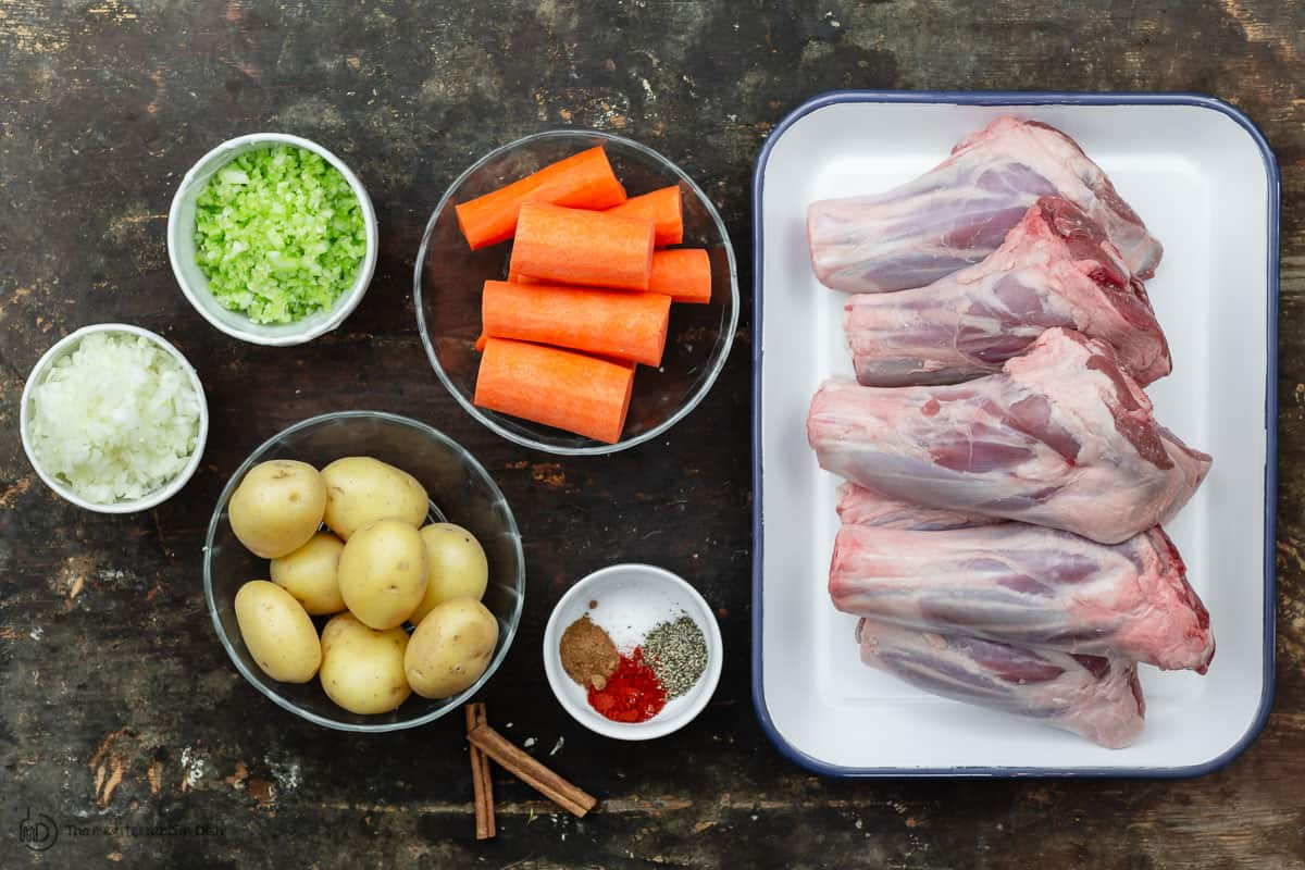 ingredients for lamb shank recipe. Lamb shanks, potatoes, carrots, celery, onions and spices