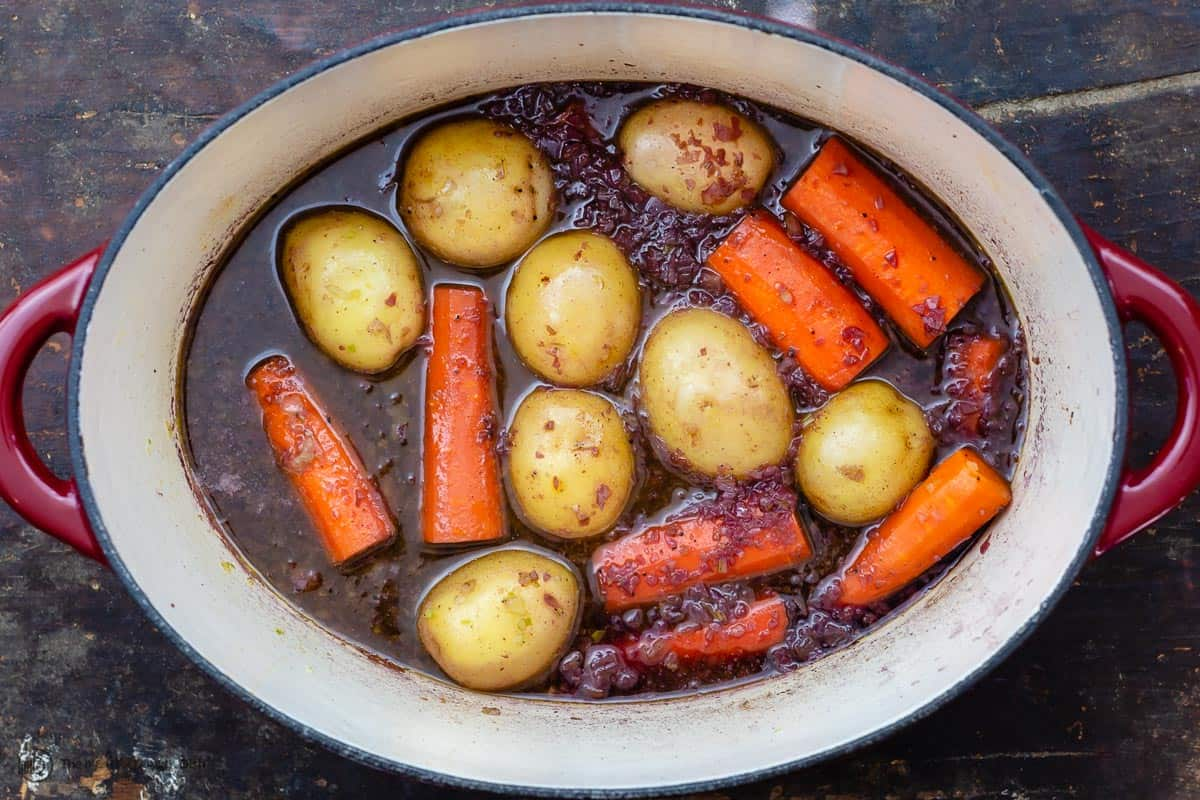 Vegetables in pot with braising liquid