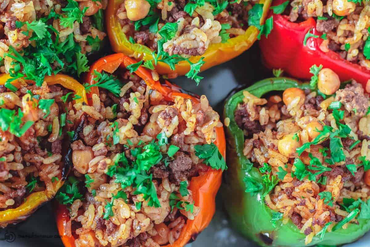 Bell peppers are assembled and stuffed with rice mixture before baking