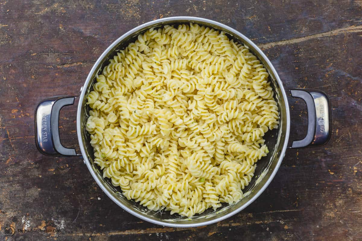 Cooked pasta tossed with Parmesan cheese in the pot