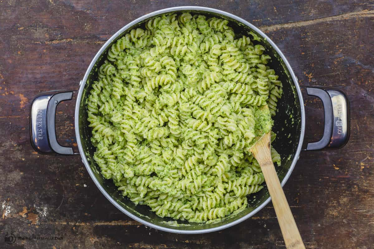 Pasta is combined with the broccoli pesto in the pot off  heat