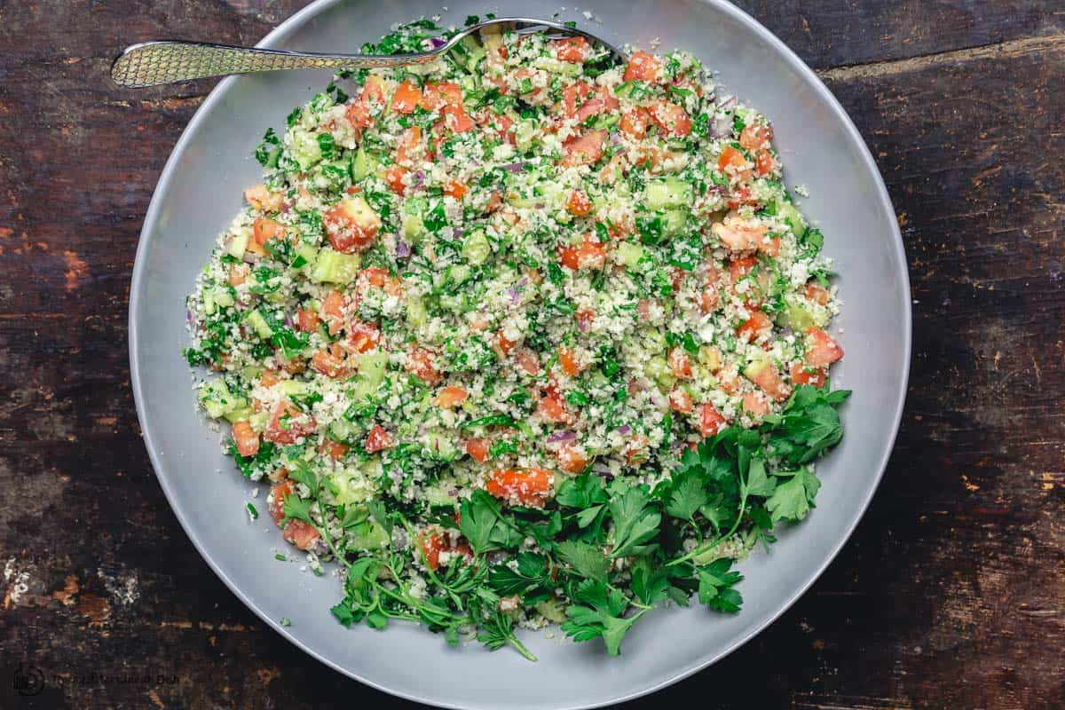 Healthy cauliflower salad, mixed and ready for serving
