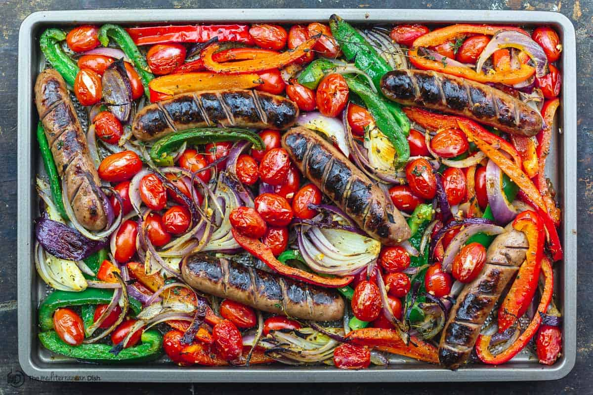 Finished sausage, onions, and peppers sheet pan