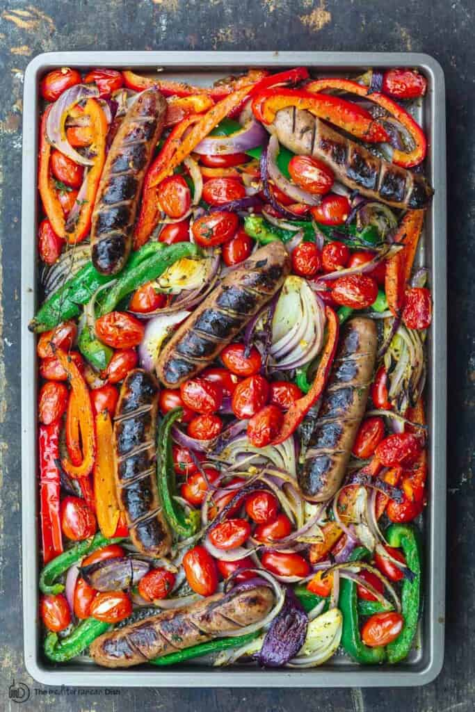 sheet pan chicken sausage and peppers with onions and tomatoes
