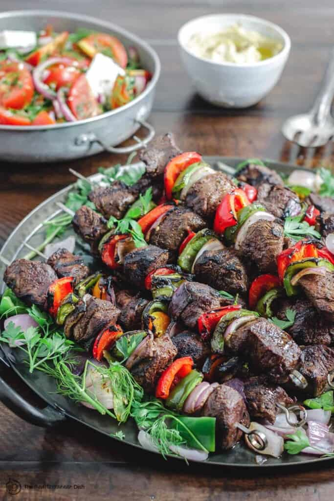 Kabobs with a side of tomato salad