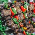Steak kabobs with bell peppers and onions served on platter