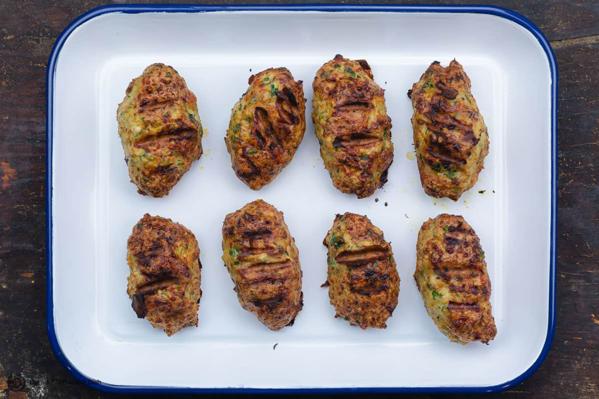 fully grilled chicken kofta patties on a tray