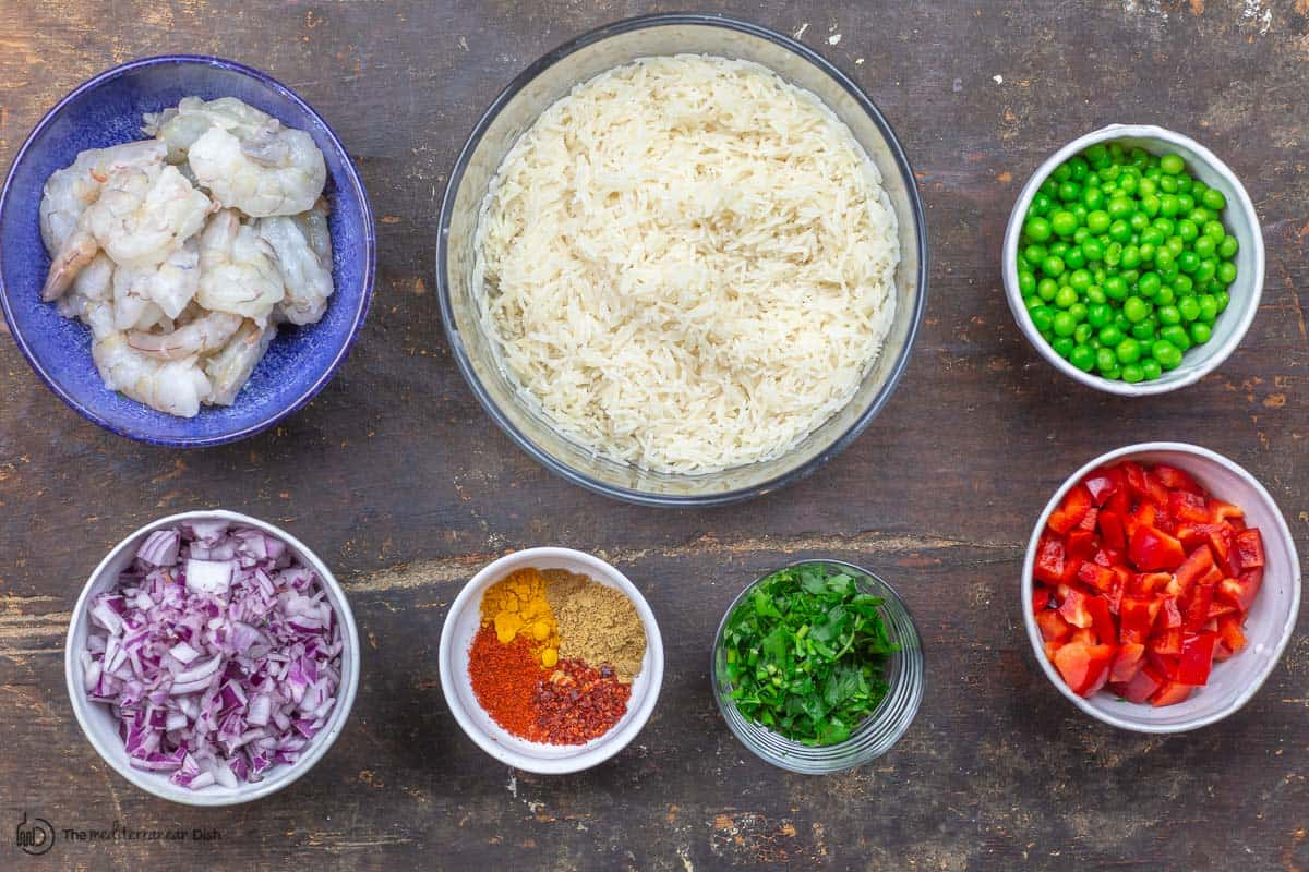 ingredients. rice, shrimp, red onions, spices, red bell peppers, peas and parsley