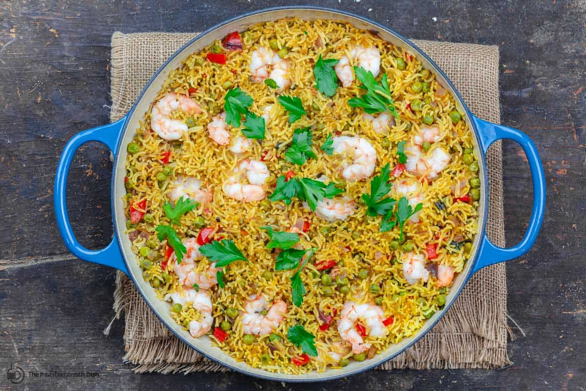 Garnish of parsley is added to this healthy shrimp and rice recipe before serving