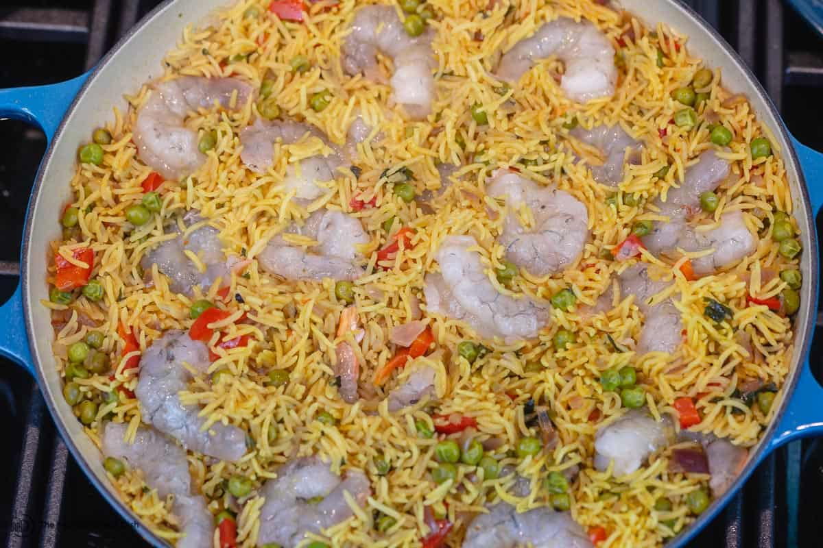 Shrimp is added to the rice