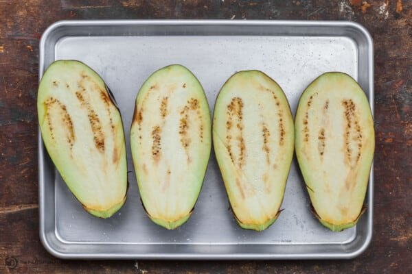eggplant cut in halves and salted