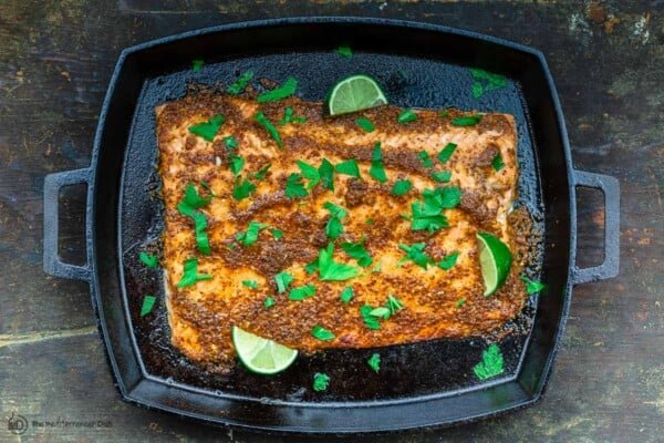 fully cooked honey mustard salmon with lime juice and parsley on top
