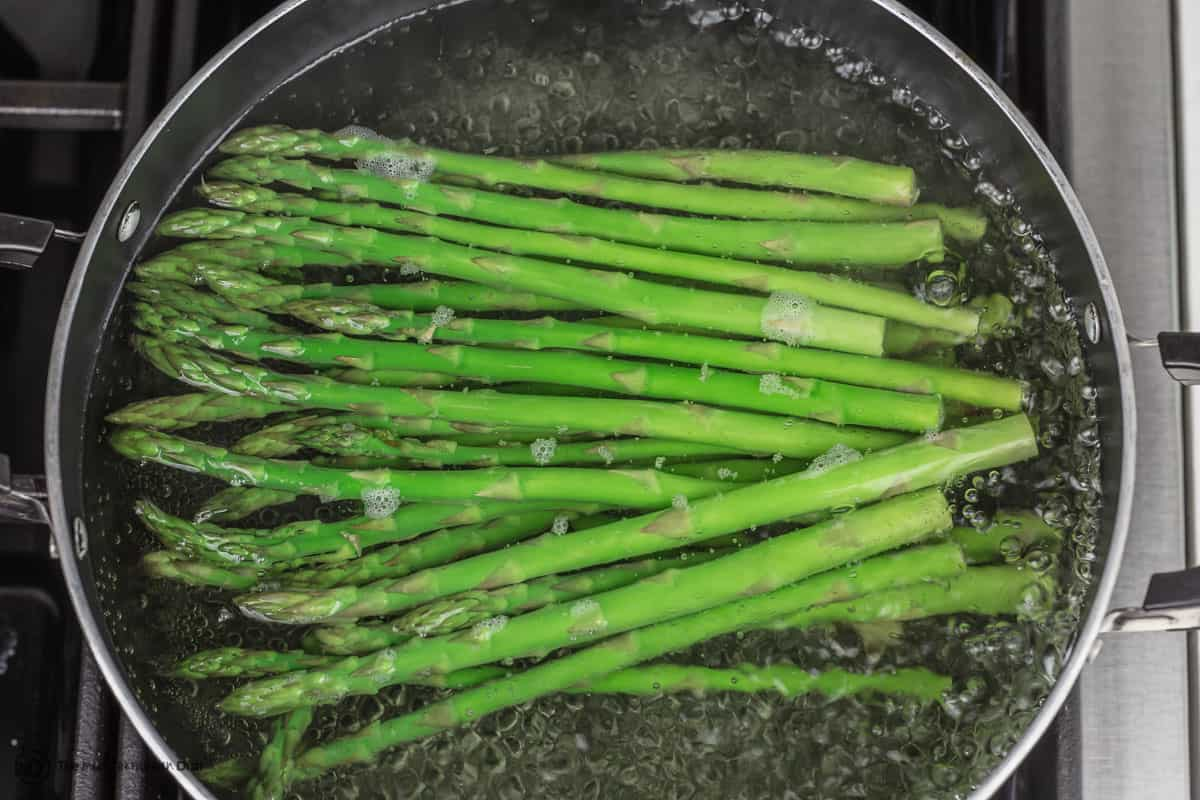 Asparagus cooking in boiling water