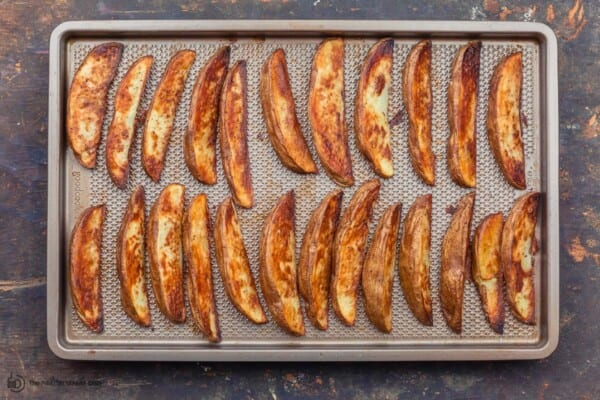 crispy potato wedges out of the oven