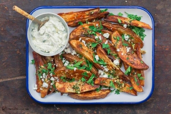 Greek baked fries (wedges) served with tzatziki sauce