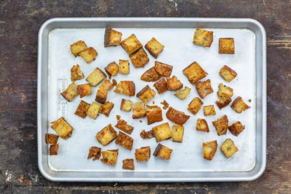Bread cubes toasted in the pan