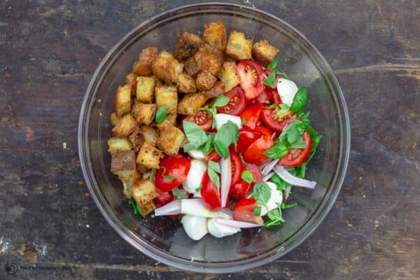 panzanella ingredients in a large mixing bowl