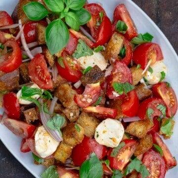 Panzanella salad platter with Italian bread, tomatoes, basil and mozzarella