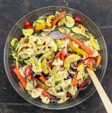 roasted vegetables and pasta tossed in a bowl