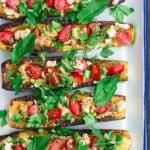 vegetarian zucchini boats assembled on serving platter