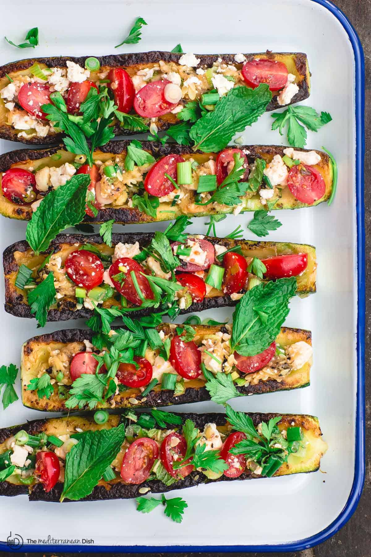 vegetarian zucchini boats assembled on serving platter