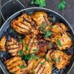 harissa chicken in the pan. a side of parsley
