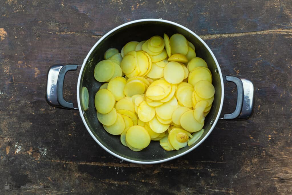 Sliced cooked poatoes in a pot