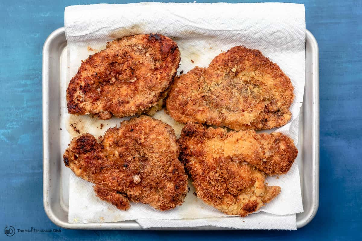 fried chicken breasts on a paper towel