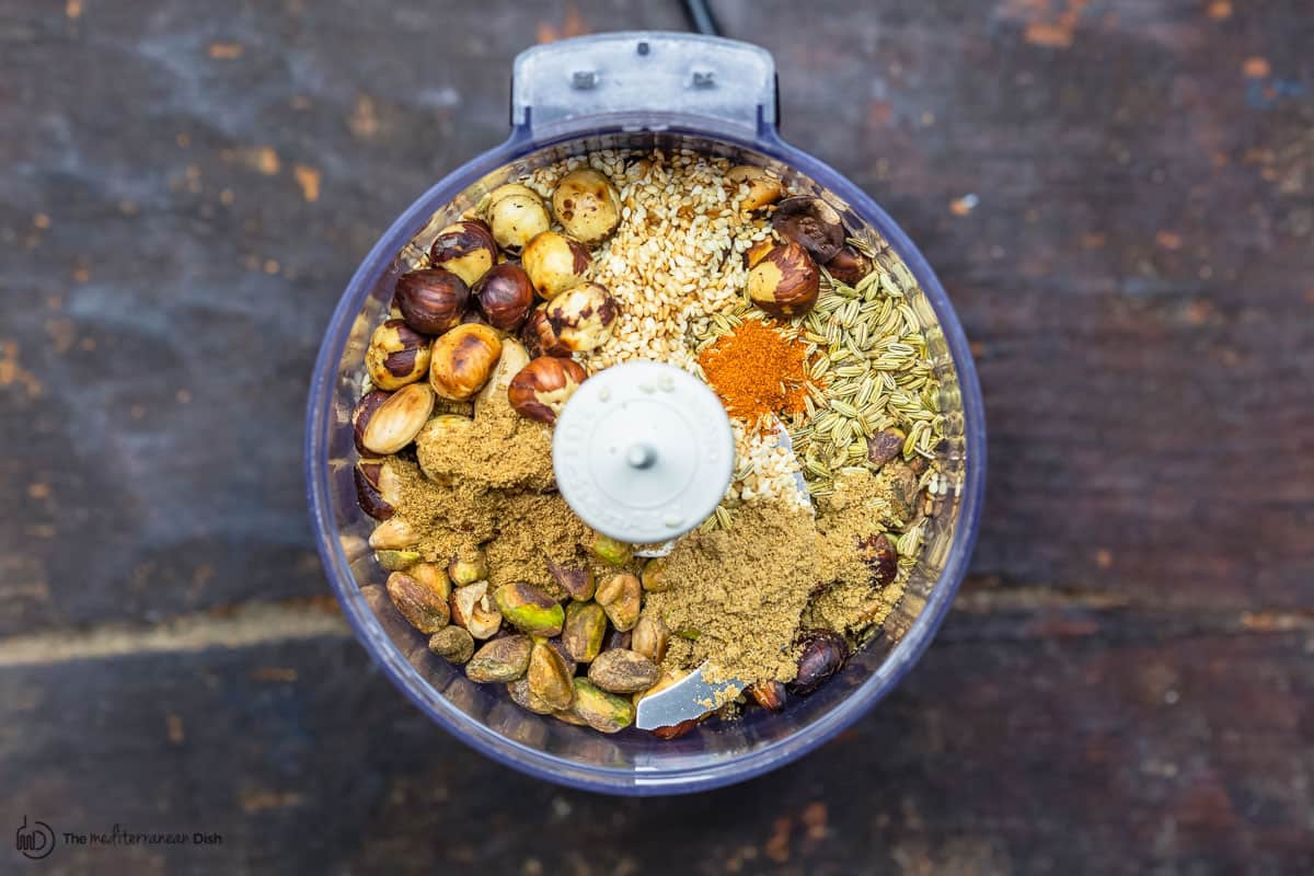 nuts, seeds, and spices in a food processor before grinding