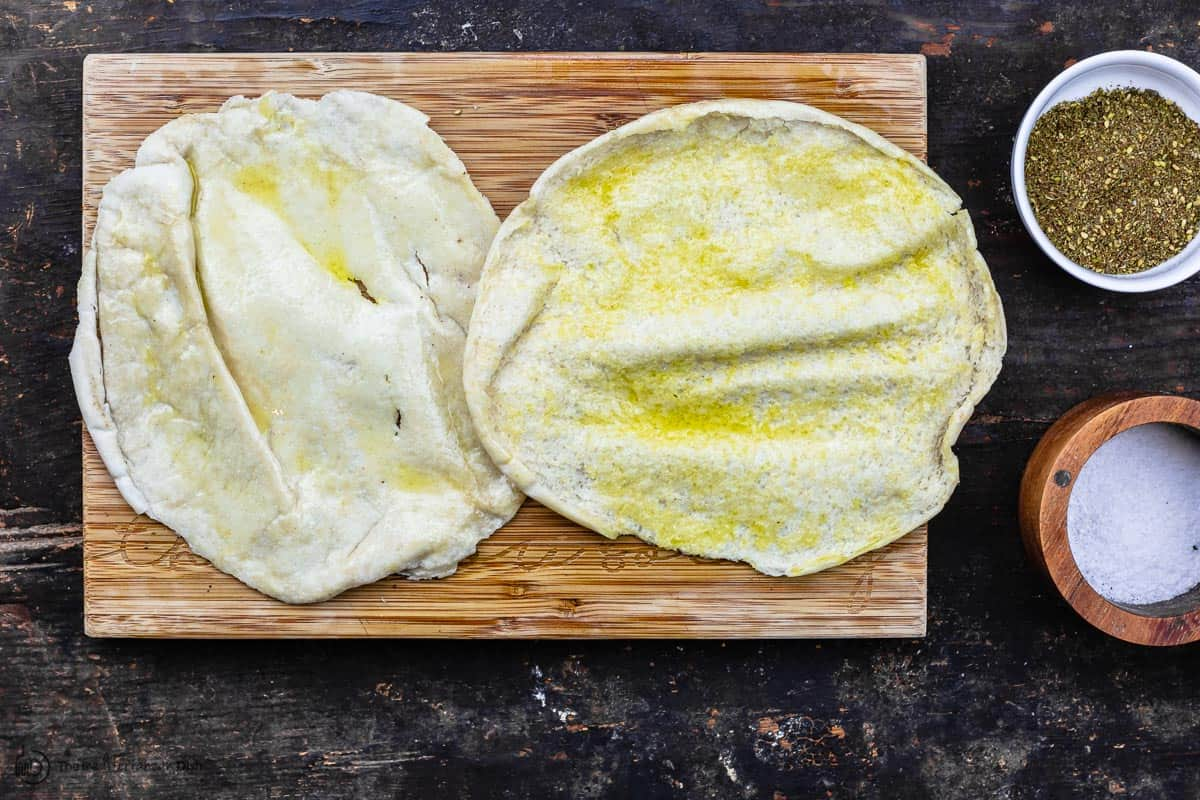 one pita pocket split into two rounds and brushed with olive oil