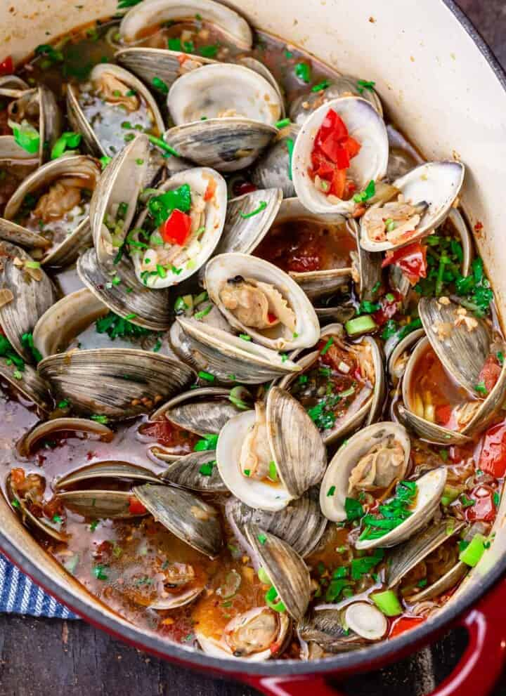 Mediterranean steamed clams in a large pot