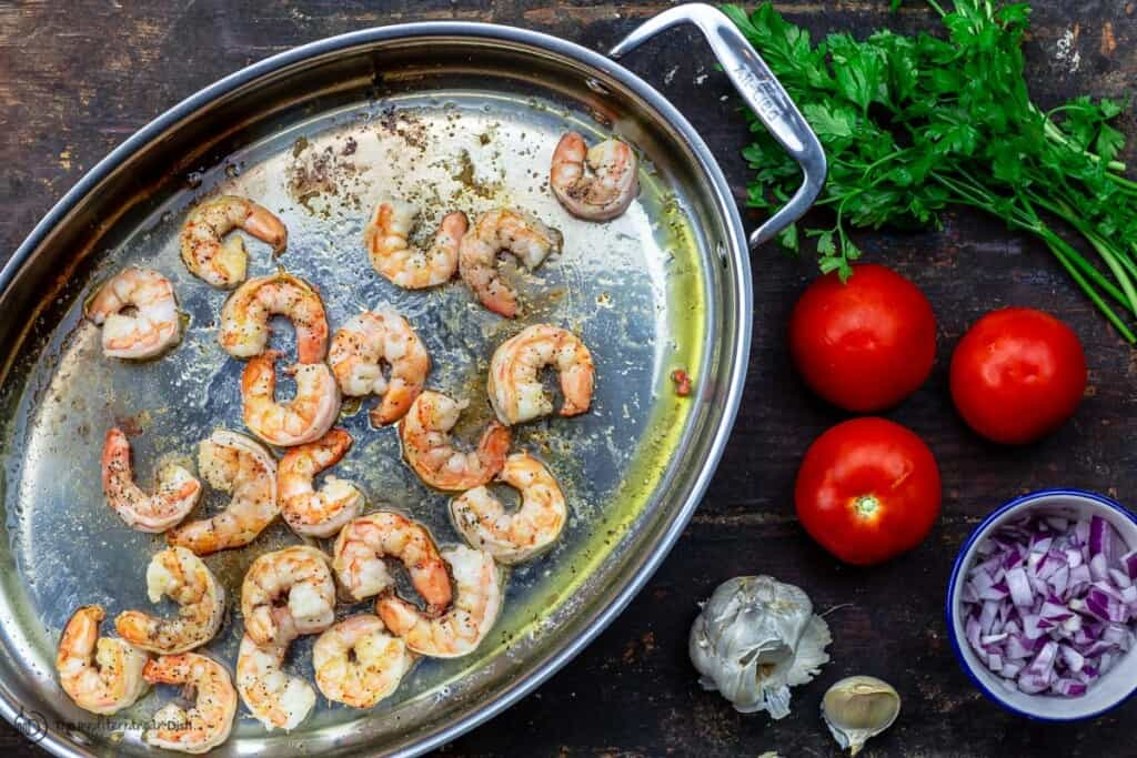 Shrimp cooked first in pan. Other ingredients to the side