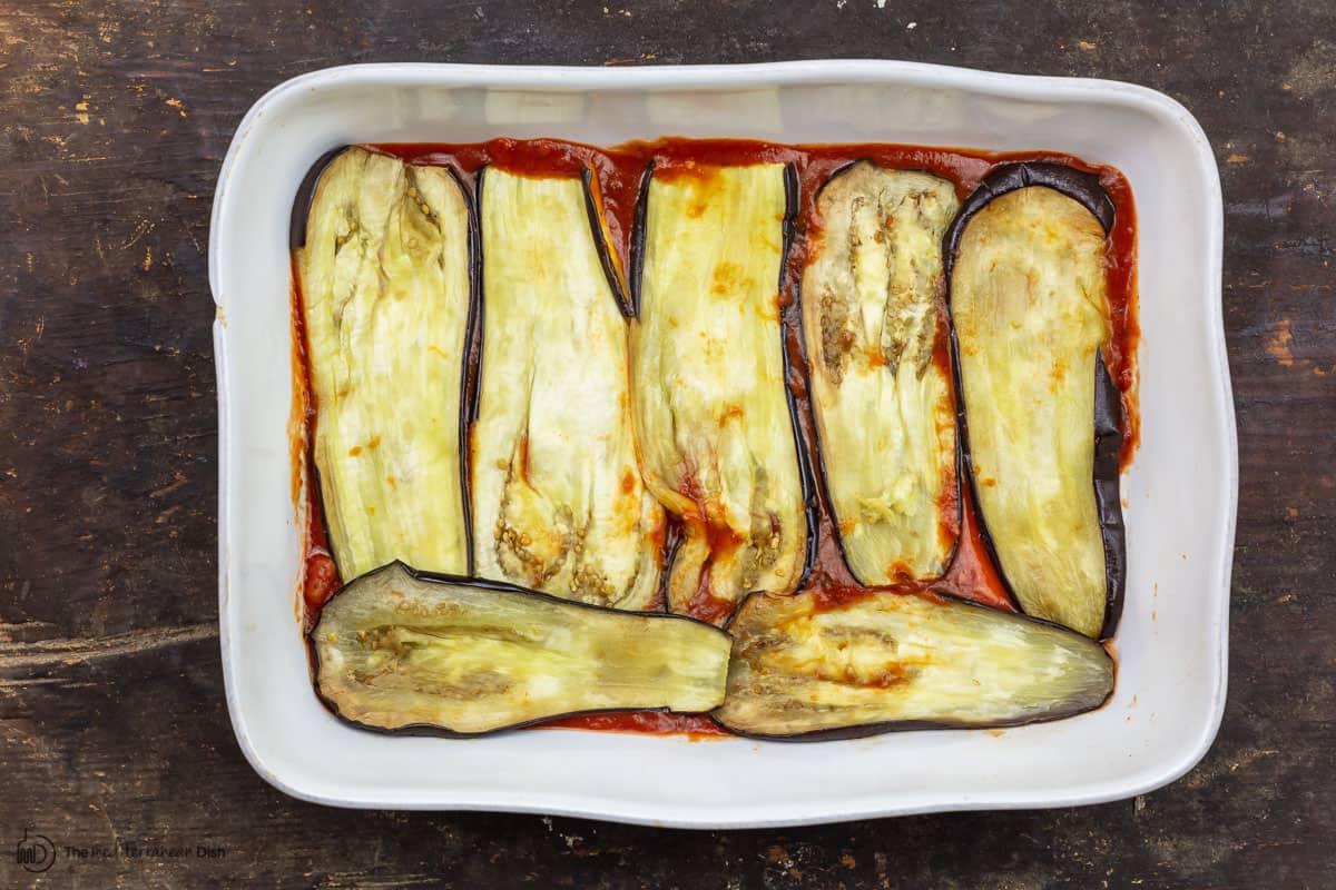 roasted eggplant spread on bottom of baking dish