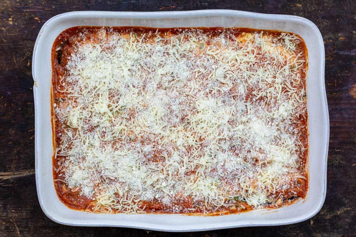 eggplant lasagna assembled in baking dish before cooking