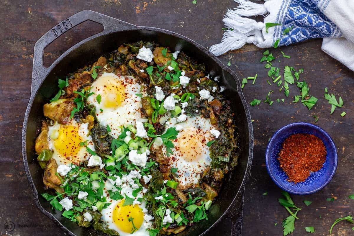 green shakshuka with a side of Aleppo chile flakes