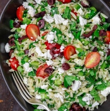 Mediterranean orzo salad in a large bowl