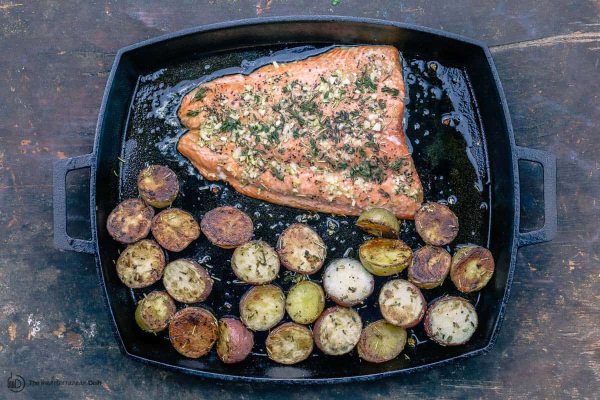 Salmon added next to potatoes for roasting