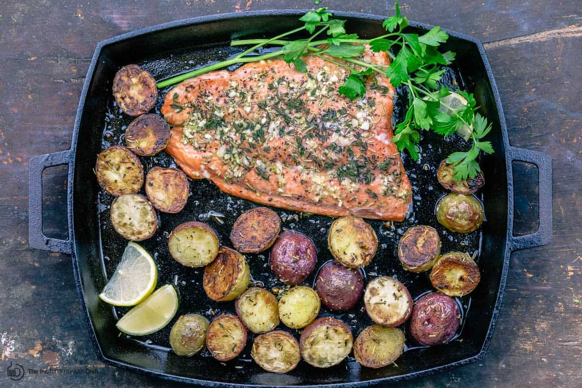 Slow roasted salmon and potatoes with parsley and slices of lemon