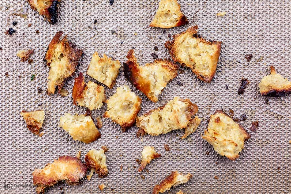 chunks of toasted bread on a sheet pan