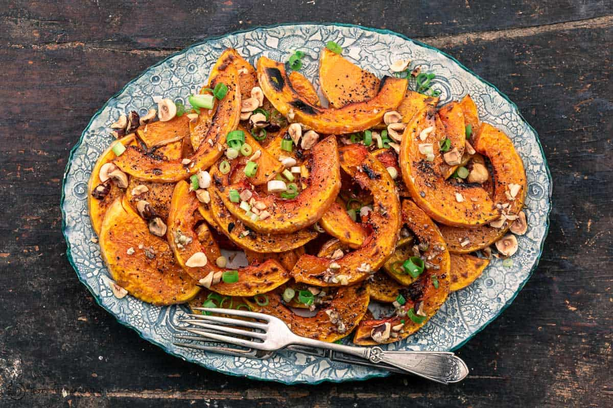 roasted butternut squash topped with lime vinaigrette, hazelnut, and scallions